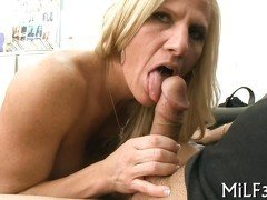 Blonde MILF sucking a fat cock and getting pounded in an office