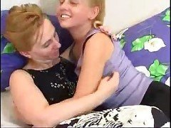 Horny mom and young hairy blonde playing