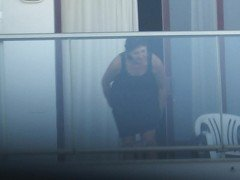 Pants off on hotel balcony