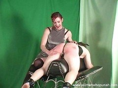 Domme spanking the slave